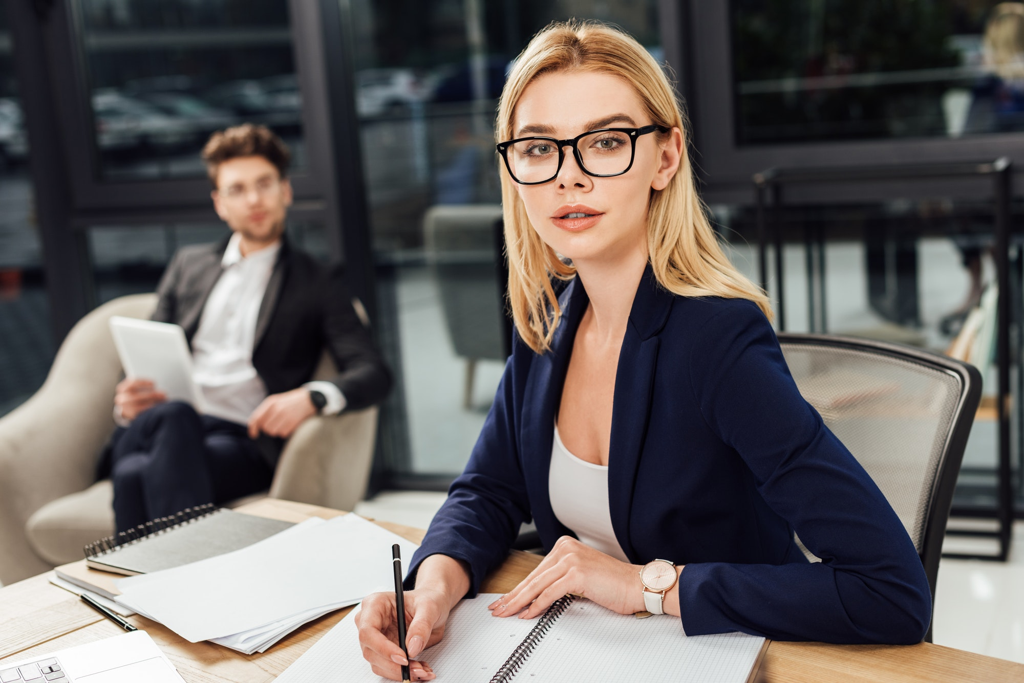 selective-focus-of-businessman-looking-at-businesswoman-in-eyeglasses-that-looking-at-camera-at.jpg